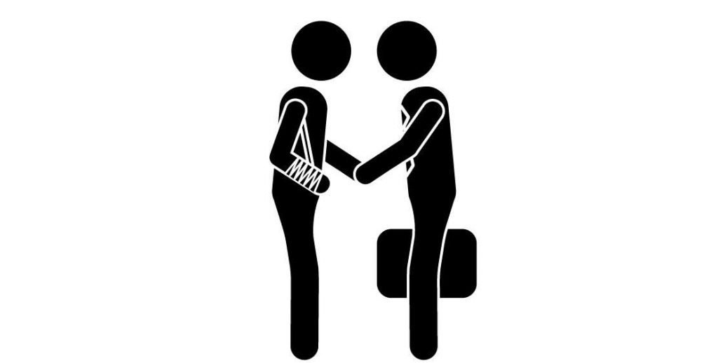 Injured person shaking hands with a person injury attorney